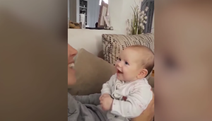 Baby lights up when mom sings Disney songs