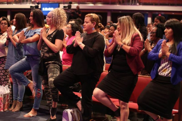 Women at Potter's House Dallas engage in yoga exercises on Aug. 4, 2018. (Photo credit: (Instagram/SeritaJakes)