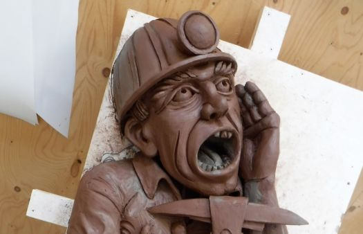 A modern twist on the medieval gargoyle at Gloucester Cathedral pays homage to generations of miners