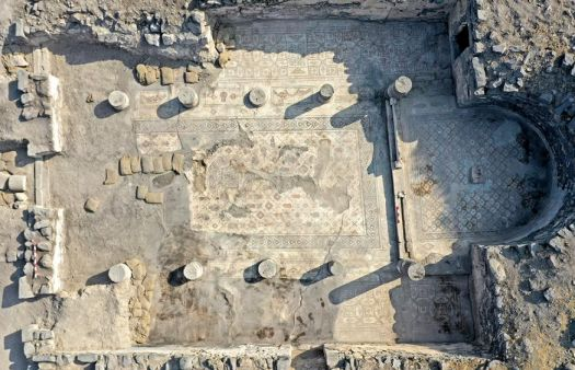 Archaeologists uncover mosaic showing five loaves and two fish near Sea of Galilee