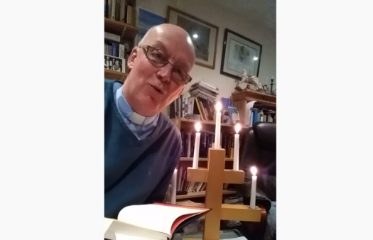 Vicar accidentally sets himself on fire during online service