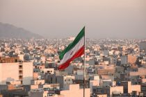 iranian-flag-waving-with-cityscape-on-background-in-tehran-iran