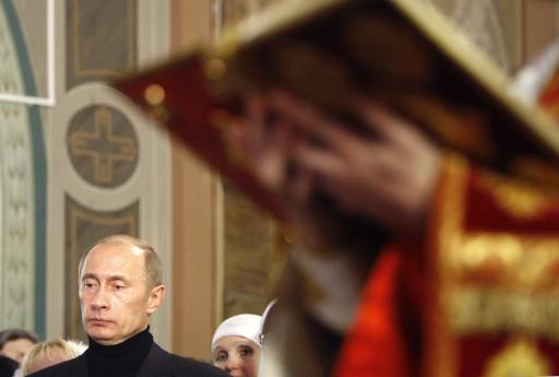 Russia's President Vladimir Putin attends a Christmas Eve service at ...