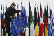 A worker adjusts the European Union flag at Farmleigh House in ...