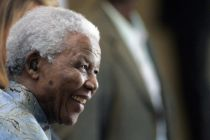 Former South African President Nelson Mandela, reacts as he leaves ...